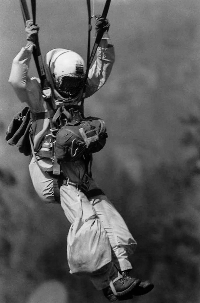 Firefighter parachuting into the forest